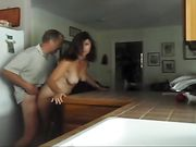 Mom and dad caught fucking in the kitchen