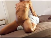 Hot mature woman reaches orgasm riding sensually a towel in bed